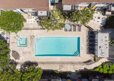 Full drone view of pool at Eastside Apartment